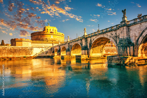 Valokuvatapetti Saint Angel Castle and bridge over the Tiber river in Rome at sunrise