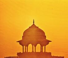 Silhouette Dome Of Taj Mahal Entrance Against Orange Sky During Sunset