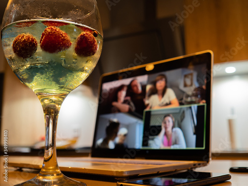Canvas Print a gin and tonic with strawberries and blue tonic during a video call
