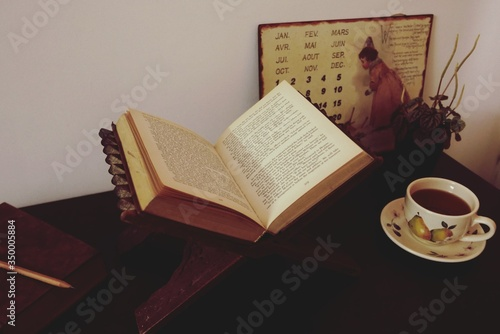 Canvastavla Close-up Of Holy Book On Table With Cup Of Coffee