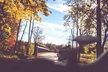Footbridge And Autumnal Trees
