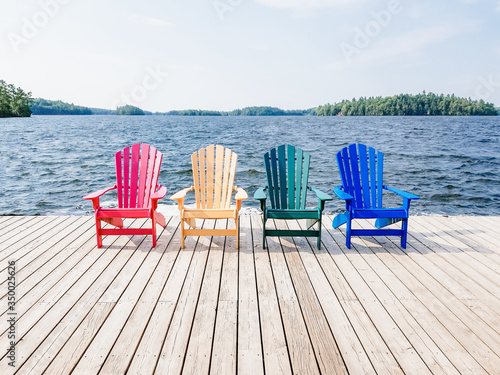 Leinwand Poster chairs by the lake cottage country