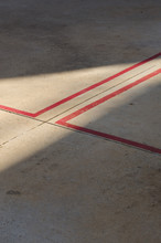 High Angle View Of Red Markings On Road
