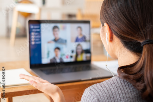 Fototapeta Young Asian businesswoman work at home and virtual video conference meeting with colleagues business people, online working, video call due to social distancing at home office obraz
