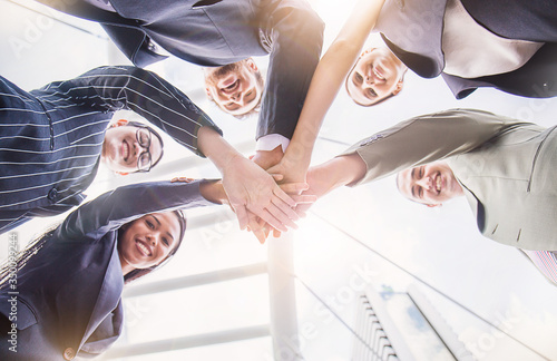 Fotografía Creative team meeting hands synergy brainstorm business man woman in circle underneath sky view