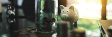 Coins Stack , A Glass Money Jar And Piggy Bank On The Table For Saving And Financial Concept