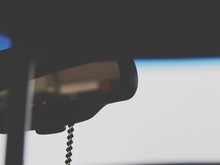 Close-up Of Rosary Bead On Rear View Mirror Of Car