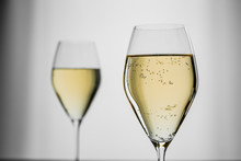 White Sparkling Wine In A Beautiful Glass On Grey Background