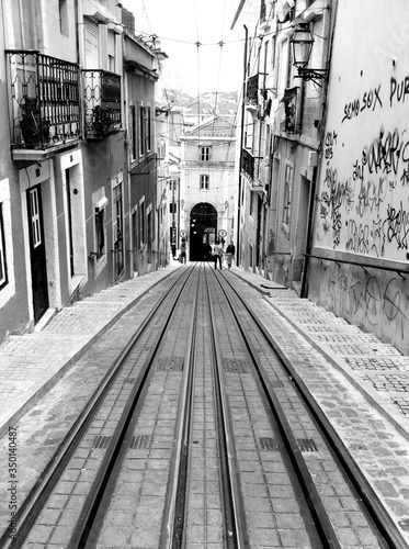 Fototapety, obrazy: Street With Railroad Tracks On Hill