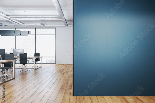 Clean coworking office interior with blank blue wall. - 350146289