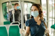 Female In Medical Mask Holding...