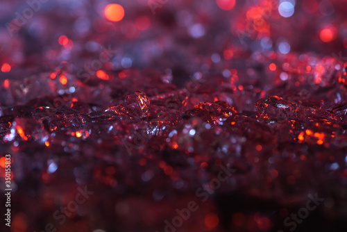 close up view of abstract red and purple crystal textured background