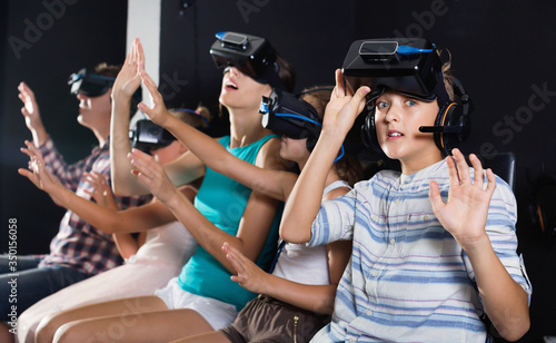 Young son is impressed of VR with family in the room. Tapéta, Fotótapéta