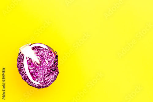 Fototapeta Red cabbage - head, cross section - on yellow background top view copy space obraz