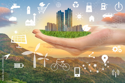 Hand hold green city with ecological icons, Save earth concept