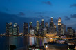 Picturesque panoramic view of Singapore city at night time. Financial and trading center hub in Asia region. Concept of success. Modern buildings in high-tech world.