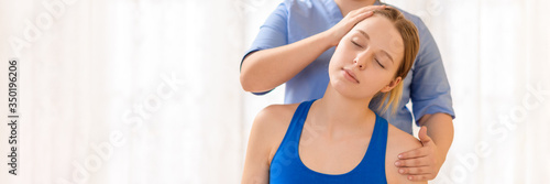 Fotografie, Obraz Female physiotherapist or a chiropractor adjusting patients neck