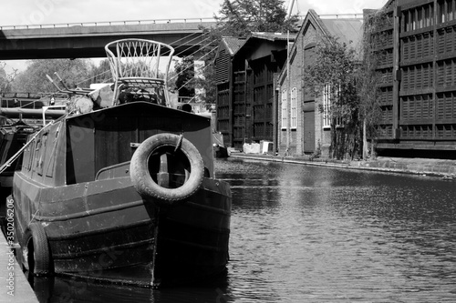 Canvas Print Old Barge Moored At Canal Pier