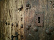 Close-up Of Keyhole On Old Wooden Door