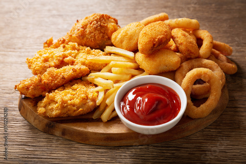 Cuadros en Lienzo fast food meals : onion rings, french fries, chicken nuggets and fried chicken