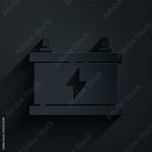 Photo Paper cut Car battery icon isolated on black background