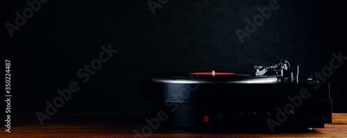 Fototapeta Turntable and vinyl records on a dark background obraz