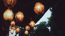 Low Angle View Of Illuminated Chinese Lanterns Hanging From Ceiling