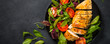 canvas print picture Chicken fillet with salad top view.