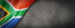 canvas print picture - South African flag on concrete wall banner