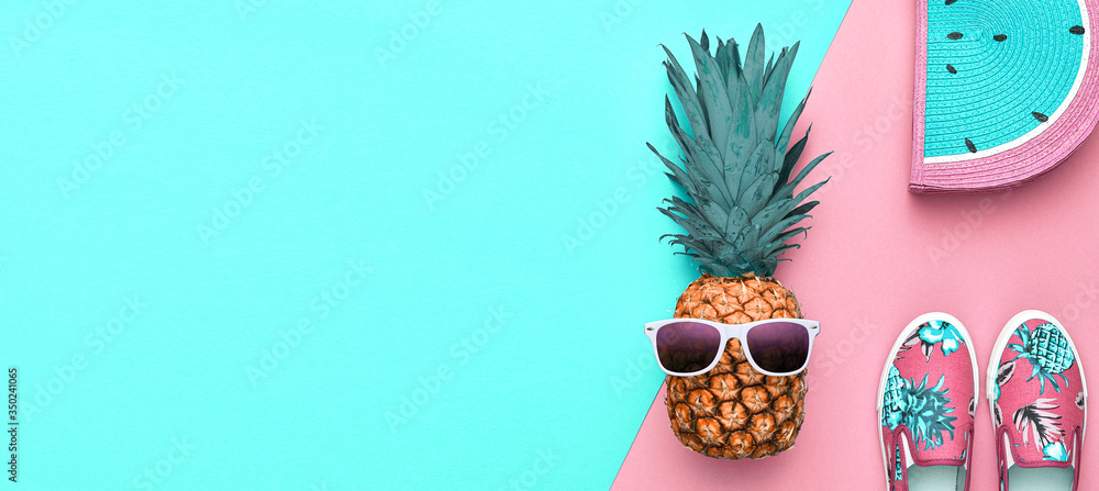 Fototapeta Fashion. Pineapple hipster in sunglasses, stylish sneakers, handbag. Minimal concept, summer accessories, tropical pineapple. Creative art fashionable concept, summertime, banner