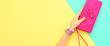 Leinwanddruck Bild Fashion. Trendy handbag clutch, female hand, accessories set. Minimal design. Stylish wrist watches, jewelry, summer fashionable woman. Creative art shopping concept on yellow, summertime
