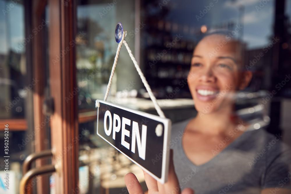 Fototapeta Female Owner Of Start Up Coffee Shop Or Restaurant Turning Round Open Sign On Door