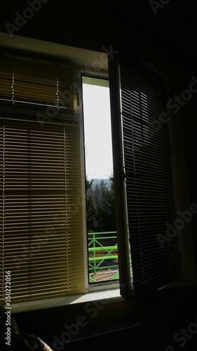Photo Clear Sky Seen Through Ajar House Window