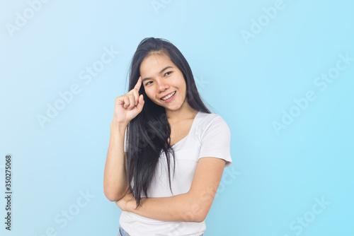 Vászonkép Beautiful young Asian woman tan skin in a white T-shirt and jean