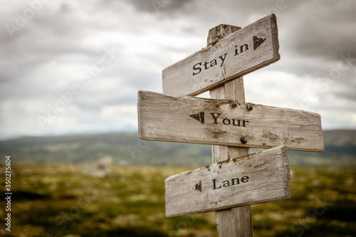 stay in your lane text engraved on wooden signpost outdoors in nature Canvas Print