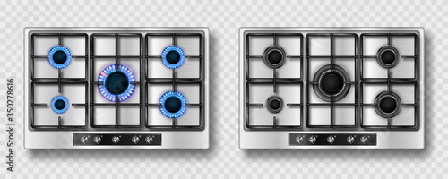 Fotografía Gas stove with blue flame and black steel grate