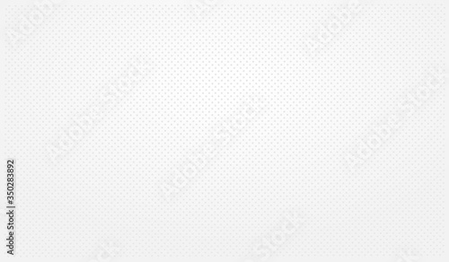 Fototapeta White perforated background with white holes and a glow