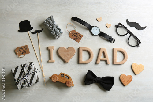 Fototapeta Flat lay composition with phrase I LOVE DAD on white background. Happy Father's day obraz