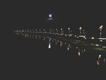 Illuminated Pier At Night