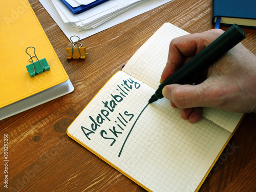 Adaptability Skills written by man on the sheet. Canvas Print