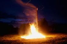 Bonfire Burning Against Moody Dusk Sky