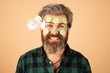 Funny man applied facial masks and cucumbers on face. Funny surprised and crazy comic concept. Facial beauty treatment.