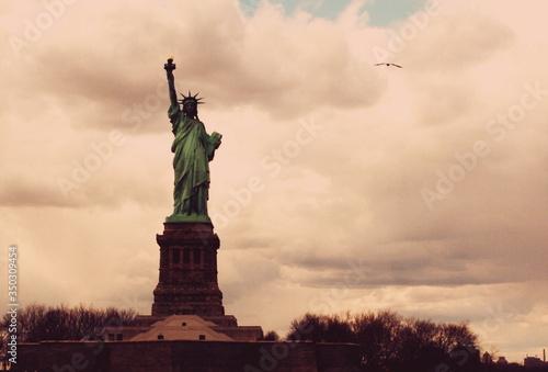 Statue Of Liberty Against Cloudy Sky Fototapeta