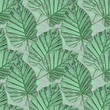 Leinwanddruck Bild - Seamless abstract pattern. Green tropical leaves on a gray stone.