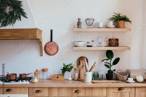 wooden rustic kitchen table. minimalistic interior, utencils on the table