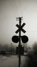 Silhouette Railroad Crossing In Foggy Weather