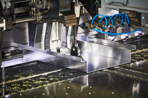 Fotomural Panel bending machine at work. process of metal sheet forming