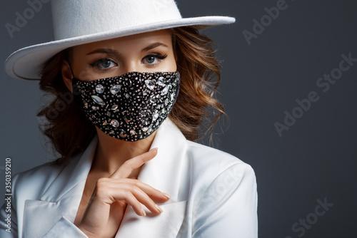 Slika na platnu Elegant woman wearing trendy fashion outfit during quarantine of coronavirus outbreak