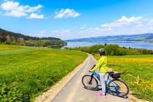 Woman Cyclist On New Cycleway Around Czorsztynskie Lake Near Niedzica Village On Sunny Spring Day, Pieniny Mountains, Poland