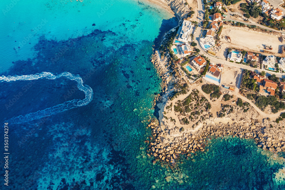 Fototapeta Tropical paradise beach with mediterranean sea water, aerial view. Travel and tourism concept.